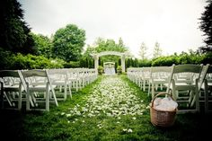 Garden wedding ceremony with flower petals down the aisle. Check out these 11 garden wedding planning tips to insure a perfect wedding event.