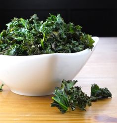 """Healthy Snacks: Salt and Vinegar Kale Chips - a friend swears by these for the inevitable """"snacking while cooking"""".  Replace oil with cooking spray for a truly guilt-free snack."""