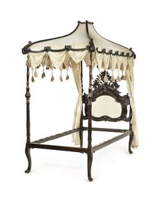 A Portuguese 18th century brass-mounted carved rosewood and ebonised single tester bed and canopy