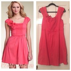 BCBG Maxazria coral dress with eyelet flowers This dress has been worn once and is in excellent used condition. It has an exposed zipper in the back and it has smocked pockets as well. This cute dress is a great spring dress! BCBGMaxAzria Dresses