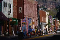 Looking down Main Street, in the heart of Telluride. Ajax Peak rises behind the town, declared a National Historic Landmark in 1964- Colorado, USA.