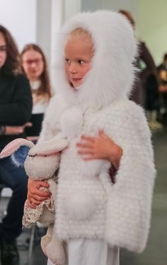 Knitted rabbit fur cape trimmed with fox.