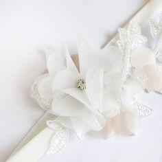 Miriam Wedding Garter | A delicate white lace wedding garter with an organdy flower and beading. A sparkly rhinestone is hidden in the middle of white organdy flower petals that create stunning 3D effect on otherwise simple and stylish bridal garter. | from Heili Bridal