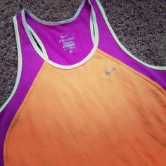 Dri-fit Nike racerback tank Nike dri-fit racerback tank in a fun purple/orange/white color combo! Gently used, just has one small snag on the bottom left corner (see pics). Nike Tops Tank Tops