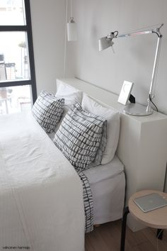 ♥ A simple headboard? It would give our room a finished look. The bedding is nice too.