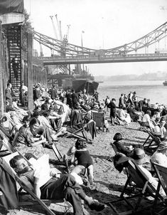 On July 1934 Tower Foreshore, by Tower Bridge, was officially opened to the public. Between over people enjoyed a day out at 'London on Sea' Uk History, London History, British History, Vintage London, Old London, Beach London, South London, Time In England, London England