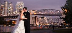 Night photo of bride and groom with the city in the background. Matt Kennedy - Portfolio Photo By www.mattkennedy.ca