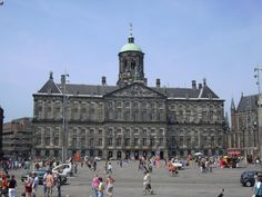 Dam Square, Amsterdam, The Netherlands .One of the places where the Queen stays.There´s a building on the left,where the wax museum of Madamme Tussaud is.