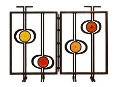 The Quadro fire screen (42 inches long by 36 inches high), inspired by a Mondrian painting, comes in a single-, double- or triple-panel wrought-iron screen with stained glass. $7,750, at Thomas Lavin, Pacific Design Center, West Hollywood, (310) 278-2456, www.thomaslavin.com. (Other sizes, finishes and glass, as well as the mesh insert are available.)