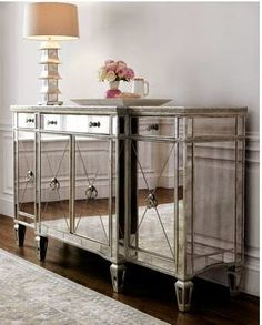 OBSESSED with the glass tables/dressers/night stands!!