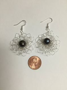 Silver plated crochet wire dangle earrings with black 10mm fresh water pearls. The fine silver plated wire and earring hooks are tarnish resistant and nickel and lead free. This is a great gift for a loved one! These earrings can also be made with large pink or white glass pearls.