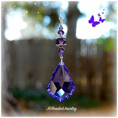 Purple teardrop crystal suncatcher for the rearview, window or ceiling light or fan pull! Unique purple teardrop crystals and many other colors! Faceted Crystal, Crystal Beads, Swarovski Crystals, Silver Beads, Car Mirror Decorations, Sun Catchers, Or Violet, Hanging Crystals, Crystal Decor