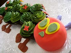 The Very Hungry Caterpillar cupcakes. This cake consists of 12 cupcakes, a 3 inch cake for the head, buttercream and fondant. This is an excellent idea for young children's birthdays.