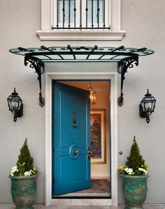 wrought iron awning with frosted glass on top of Beautifully Artistic Front Door Canopy Front Door Awning, Front Door Canopy, Metal Awning, Door Overhang, Metal Door Canopy, Wooden Canopy, Exterior Colonial, Traditional Exterior, Canopy Outdoor