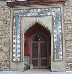 "The front door of the house is flanked by two tile-lined niches lined with vividly colored Middle Eastern-inspired tile, which looks as fresh today as it did more than 100 years ago. Over the door is an inscription of ""Welcome"" in Arabic."