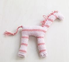 Silly Striped Giraffe-Knitted flat and seamed together, you can make this animal friend and create a cuddly toy zoo for the playful child in your life.