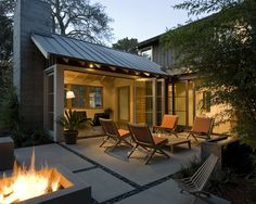 Small sunroom/ outdoor transition Style of exterior, but more natural wood large concrete pavers / slabs