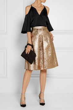 Oscar de la Renta Pleated metallic brocade skirt $1,790 Gold brocade  Concealed hook and zip fastening at back 54% wool, 24% silk, 21% polyester, 1% polyamide; lining: 100% silk Dry clean Made in Italy