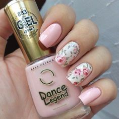 Simple and very pretty rose nail art design. The design looks very charming with the pink roses painted over the white nail polish as background. You can also see the light pink nails that have been painted to add variety to the design. #Nails #NailArt #NailsDesign #Beauty