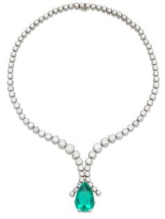 An emerald and diamond necklace The graduated brilliant-cut diamond chain suspending a detachable pear-shaped emerald drop, weighing 24.41 carats, accompanied by a brilliant-cut diamond line brooch