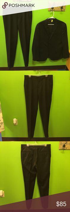 Egara slim fit black suit men's size 44R Egara slim fit black suit men's size 44R--pants size 36x32---made in Indonesia--100% wool--in excellent like new condition egara Suits & Blazers Suits