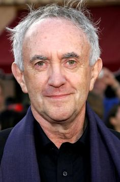 Jonathan Pryce (b. 1947)   ------ made his breakthrough screen performance in Terry Gilliam's 1985 cult film Brazil.    Critically lauded for his versatility, Pryce has participated in big-budget films such as Evita, Tomorrow Never Dies, Pirates of the Caribbean and The New World, as well as independent films such as Glengarry Glen Ross and Carrington. His career in theatre has also been prolific, and he has won two Tony Awards.