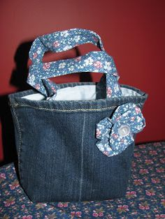 Jean purse...  shows (not super well, though) how to create a flat bottom