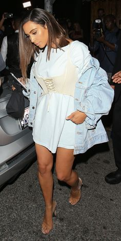 Kim Kardashian Wears a Cream Corset Over Her T-Shirt Dress from InStyle.com