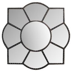 Create an artful focal point in your entryway or parlor with this eye-catching wood wall mirror, showcasing a quatrefoil silhouette. P...