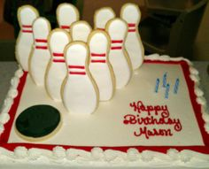 Bowling Birthday cake...like that cookies were used for pins
