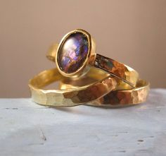 A customer set me her old gold jewelry and I remade it into this set of rings set with an ammonite fossil cabochon.
