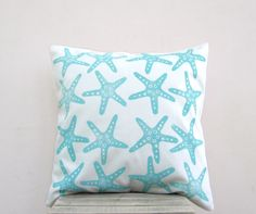 Aqua throw pillow: starfish print in aqua turquoise on white organic cotton nautical pillow cushion cover, beach cottage decor. $38.00, via Etsy.