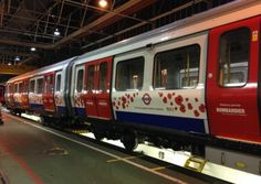 A Circle line train decorated in a poppy design in support of London Poppy Day. Picture: Transport for London