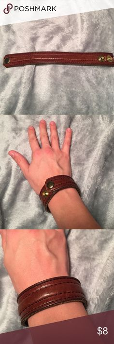 Hand made leather belt bracelet. Brown leather belt handmade bracelet. Has two gold snaps so it is adjustable, but fits a smaller wrist. A few scratches on the leather. Jewelry Bracelets