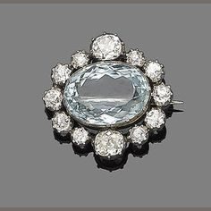 A late 19th century aquamarine and diamond brooch The large oval mixed-cut aquamarine within a cushion and old brilliant-cut diamond surround, mounted in silver and gold, diamonds approx. 2.30cts total, aquamarine possibly later, width 2.5cm
