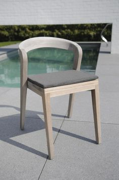 Play Chair - Wildspirit. Elegant massive wooden chair with a unique contemporary design. Typical characteristics are: easy stackable, ergonomic comfort, compact luxurious, for project and residential business, approved for indoor and outdoor use.  #outdoor #furniture #chairs #luxury #wood