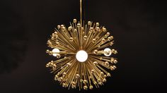 VIDEO: https://vine.co/v/huzmLj9hW6E  This gold beaded urchin pendant is MADE TO ORDER with a lead time of 3-4  weeks.  Measurements: - Diameter: 15 in - Height: 12 in - Weight: 10 lbs  Features: - Gold acrylic beads (20 mm diameter) - Hundreds of antique gold metal spines - Three candelabra-base (E12) light sockets - Brass plated finishes  Fixture Includes: - Simple matching canopy set - 6-ft electrical cord - 3-ft chain with removable links; Additional chain or a rod can be  purchased at…