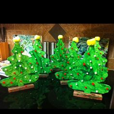Buy wooden Christmas trees at a craft store then let your toddler handprint them green.  After the dry apply glue dots and let your toddler add fuzzy balls as decorations and a yellow one on top for the star!  Tons of fun and great time together playing.  Write their name and the year on the bottom and give them to the grandparents--- they LOVE them!