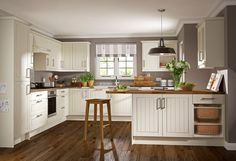 taupe walls with ivory kitchen cabinets - Bing images Taupe Kitchen, Peninsula Kitchen Design, Taupe Walls, Ivory Kitchen, Symphony Kitchen, Kitchen Fittings, Kitchen Gallery, Kitchen Design, Timeless Kitchen