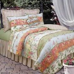 """Cotton quilt with a floral patchwork motif.  Product: QuiltConstruction Material: 100% CottonColor: Blue, green, peach and whiteDimensions: Full/Queen Quilt: 90"""" x 90""""   Cleaning and Care: Machine washable"""