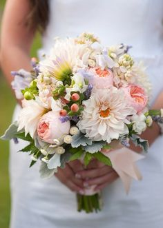 Pink spring bouquet with cabbage rose and hypericum berry