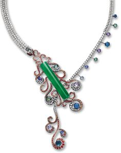 "Jadeite, colored sapphire, and diamond ""Phoenix"" necklace by Violetto.      Set with a highly translucent jadeite double curved plaque of emerald green colour, amid scrolls pavé-set with circular-cut orange sapphires and brilliant-cut diamonds, completed by a stylised brilliant-cut diamond-set necklace, highlighted by octagonal-cut coloured sapphires of blue, pink, purple and green colours,the diamonds and sapphires together weighing 12.00 and 12.50 carats respectively."