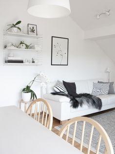 Scandinavian style interior, white sofa with grey Icelandic sheepskin