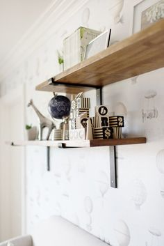 Open wooden shelves for your baby's nursery: http://www.stylemepretty.com/living/2016/12/16/the-most-magical-nurseries-of-2016/ Photography: Julie Cate - http://www.juliecate.com/