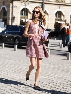 Olivia Palermo steps out in a plunging neckline checkered Dress, a silk scarf, and pointed toe flats.