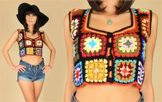 *Vintage 1970s Crochet Crop Top  *Black + Rainbow Colors  *Handmade Granny Square Details  *Button Front  *Adorable vintage Artisan Piece!    *Size: Small--Please check measurements to ensure proper fit! Measurements  *Shoulder to Shoulder: 14 inches  *Bust: 32 1/2 inches  *Waist: 32 inches  *Hips: n/a  *Length: 16 inches *Color: Black/Multi    *Material: Acrylic    *Label: Handmade by someones Granny!! :)    *Condition: Excellent Vintage Condition!    Please convo us with any ...