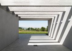 OSM submerges concrete home in a hill above Italy's San Giuliano lake.