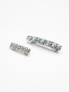 Heirloom Barrette Set   Set of two different sized hair barrettes each featuring tribal inspired metal etched detailing.  The larger barrette has statement turquoise colored stones.