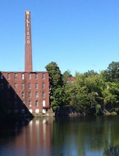 The Millyard Chimney behind the Pickering building on the Nashua River, Nashua, New Hampshire. Nashua New Hampshire, Beer Club, Love Craft, Tasting Room, Willis Tower, Main Street, Dog Friends, Brewery, New England