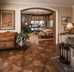Though this intricate pattern is not commonly seen in this part of the world, it's quite popular in the grand villas of Tuscany, Italy. Hand-scraped walnut planks are inlaid with maple and the entire floor is burnished, waxed and buffed to highlight the natural patina of the wood. Quanto bello!   See more at Schenck and Company:  http://www.schenckandcompany.com/workTUSCAN_TRADITIONAL.html